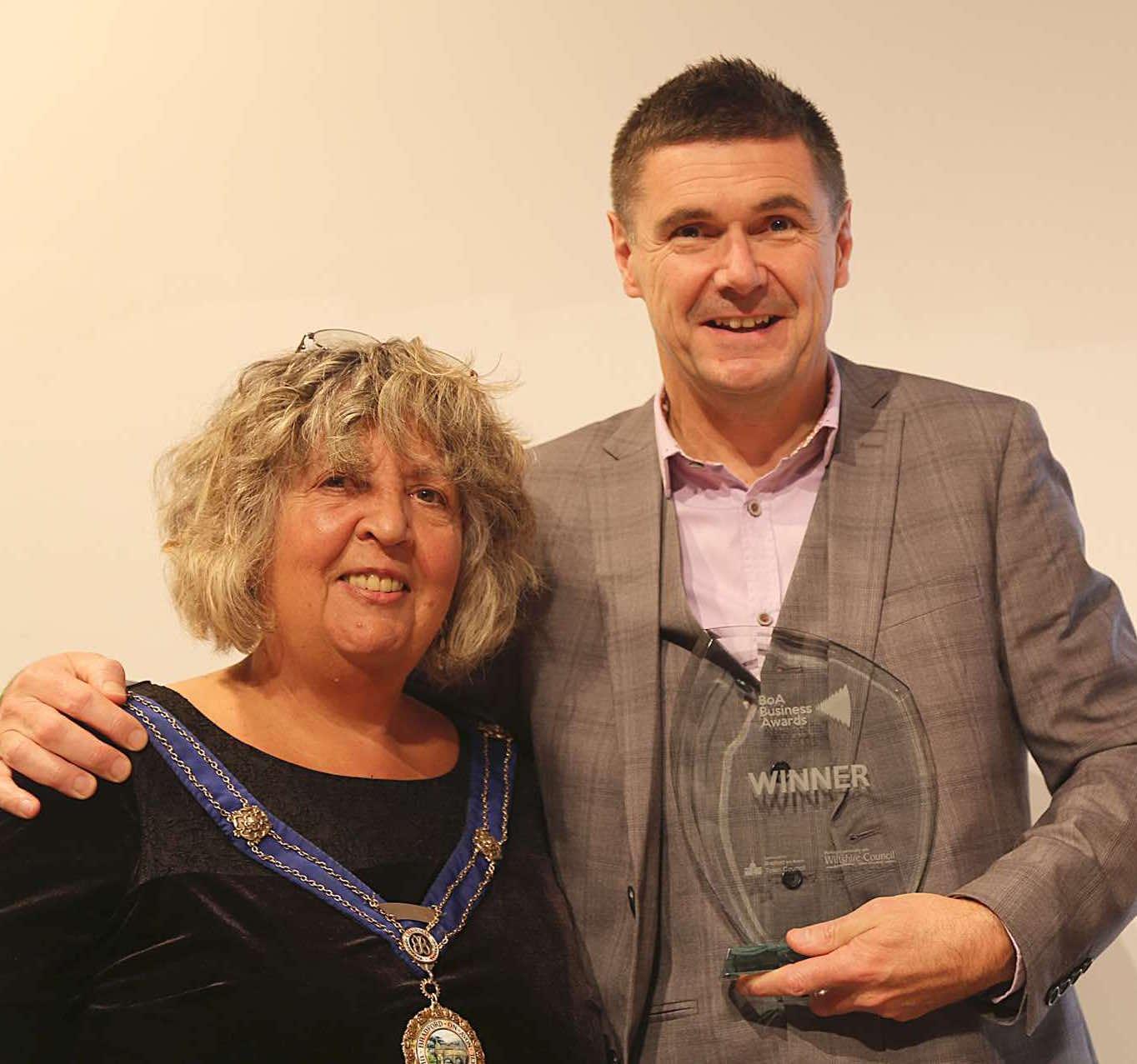 Neil Coxon receiving BOA Business Award
